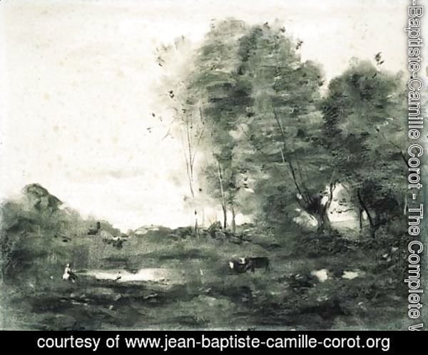 An extensive wooded landscape with cows
